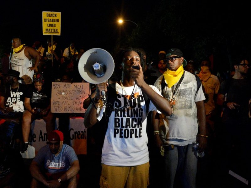 A Black Lives Matter protester addresses fellow protesters near the site of Democratic National Convention in Philadelphia, Pennsylvania, U.S., July 26, 2016.  REUTERS/Bryan Woolston - RTSJTEK